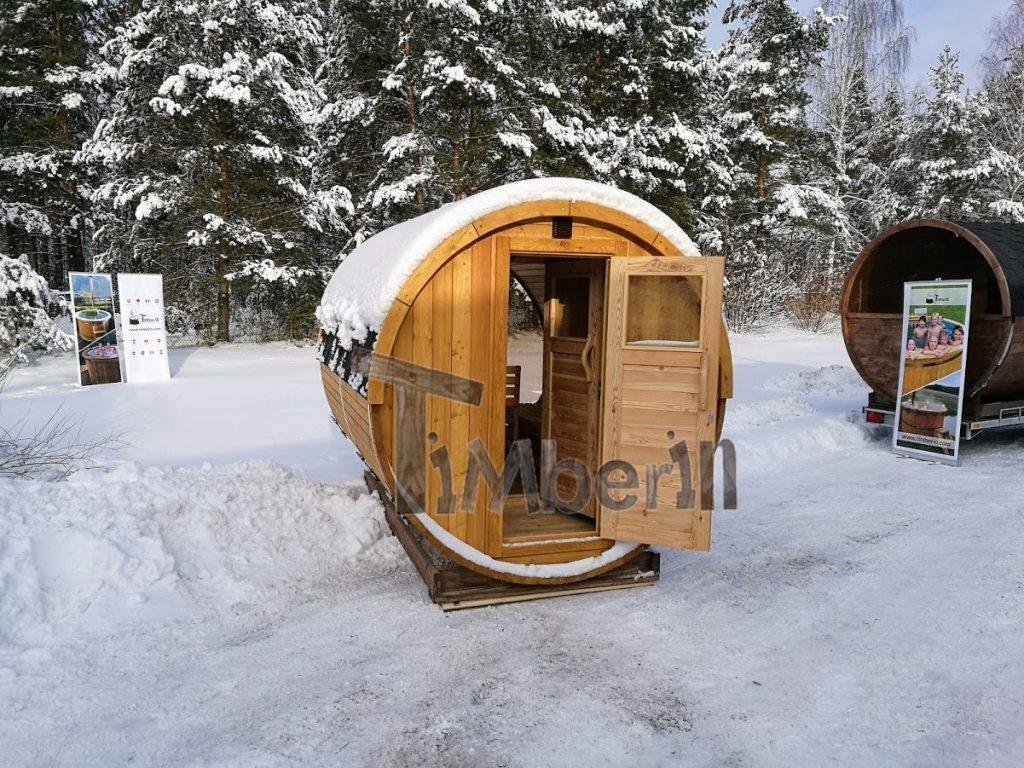 Outdoor barrel sauna with full panoramic window in winter (1)
